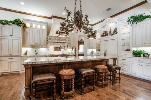 recreate victorian opulence in a fabulous kitchen featuring white cabinets and exquisite brown leather stools