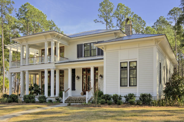 spotlight the beauty of white color in this mid-sized traditional home with black shutters