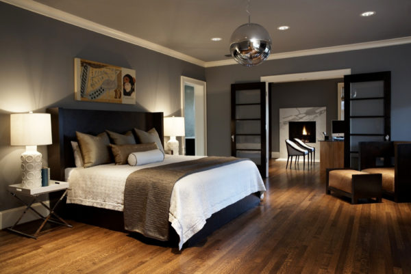 try a cozy bedroom nook with a black headboard, grey walls, and warm lighting