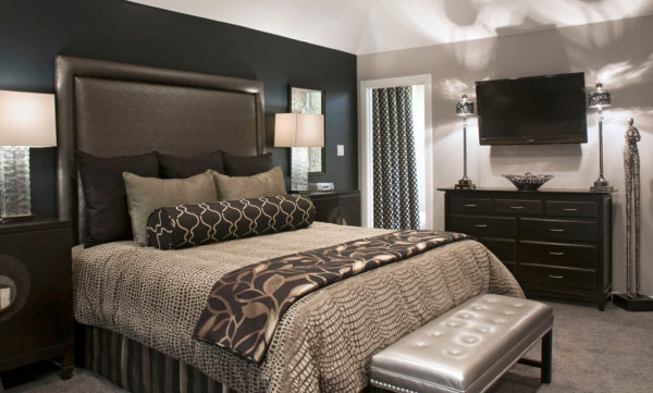 use an accent wall with coffee bean paint against the white walls and gray carpets