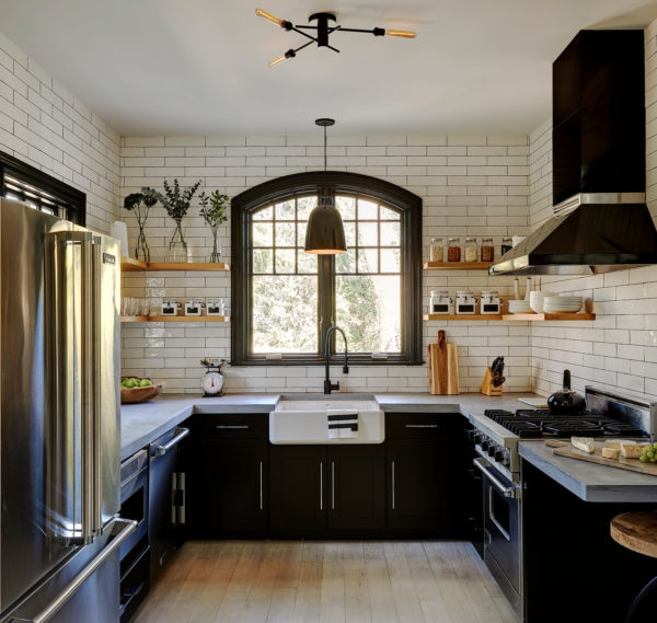 build a charming farmhouse kitchen using subway tile with black grout walls and stainless-steel appliances