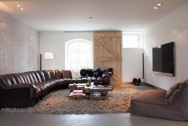 large barn door as the window shutters to blend historic and modern features for a comfy living space