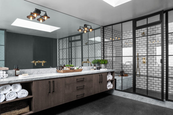 try an industrial bathroom featuring subway tile with black grout shower walls and marble countertops
