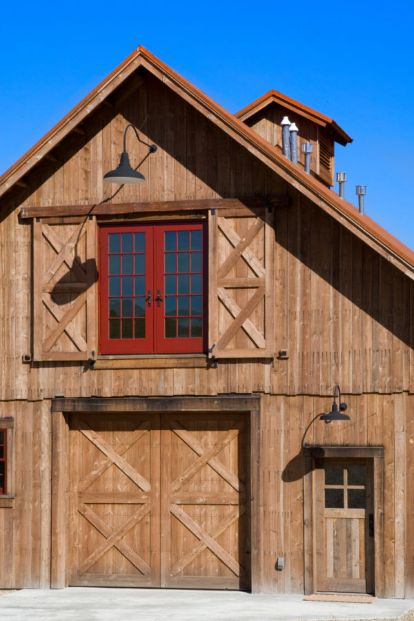 try custom wood window shutters to match the front door for a rural-inspired barn house